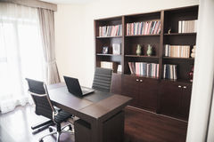 Modern home office with bookshelves. Royalty Free Stock Images