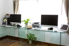 Modern home office with computer and labtop Stock Images