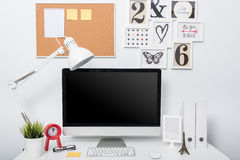 Modern home office computer monitor Stock Photos