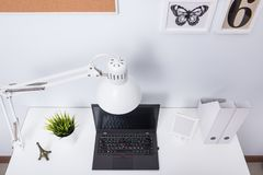 Modern home office notebook laptop computer. Workspace on white desk Royalty Free Stock Photo