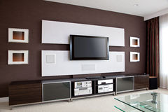 Modern Home Theater Room Interior with Flat Screen TV. Brown wall Royalty Free Stock Photography