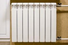 Modern home white radiator heating. Replacement, repair, installation of radiators, close-up photo. stock photo
