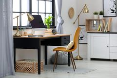 Modern home workplace with wooden crates royalty free stock photography