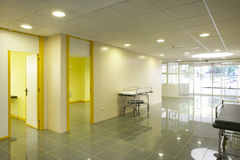 Modern hospital emergency entrance in yelow tone. Modern hospital emergency entrance in yellow tone. Horizontal Stock Image