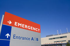 Modern hospital emergency sign and building Stock Images