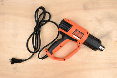 Modern hot air gun. On wooden background Royalty Free Stock Photo