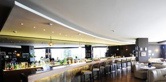 Modern Hotel bar. Beautiful brand new spacious hotel bar during day royalty free stock photos