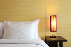 Modern hotel bedroom. Closed up pillow and bedside Royalty Free Stock Image