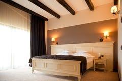 Modern hotel bedroom Stock Images