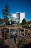 Modern hotel exterior with pond Stock Image