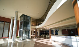 Modern hotel lobby. Interior of a modern hotel, spacious lobby, check in desk and elevator shaft Stock Photo