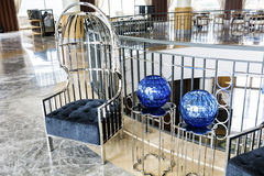 Modern hotel Lobby Interior Design. Fragment of the lobby of the five stars luxury hotel. Lounge area. Interior design. metal  chairs and table with blue vases Stock Photos