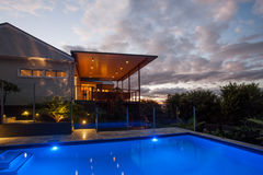 Modern hotel with a pool at night with light sky stock photography