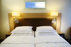 Hotel apartment room interior with bed. royalty free stock photo