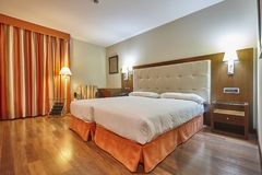 Modern hotel room interior with two separate beds. Tourism. Business royalty free stock photo