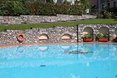 Modern hotel with a swimming pool royalty free stock images
