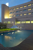 Modern hotel and swimming pool by night Royalty Free Stock Photo