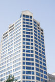 Modern Hotel Tower Under Blue Sky. Modern Office Tower Rising into the Sky Royalty Free Stock Image
