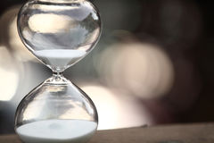Modern Hourglass on bokeh background. Symbol of time. countdown Royalty Free Stock Photos