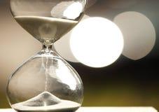Modern Hourglass on bokeh background Stock Photos