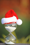Modern Hourglass and Christmas countdown. Christmas countdown. Modern Hourglass and Christmas tree -- sand trickling through the bulbs of a crystal sand glass Royalty Free Stock Image