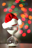 Modern Hourglass and Christmas tree. Christmas countdown. Modern Hourglass and Christmas tree -- sand trickling through the bulbs of a crystal sand glass. space Stock Image