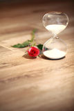 Modern hourglass and red rose with copy space. Valentines day countdown Stock Photo