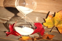 Modern Hourglass. symbol of time. countdown. Modern Hourglass -- sand trickling through the bulbs of a crystal sand glass. symbol of time. countdown. Time Royalty Free Stock Photography