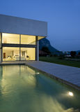Modern house. A summer night royalty free stock photo