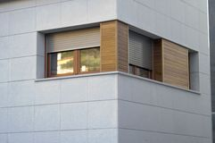 Modern house. A modern house with wood windows Stock Photos