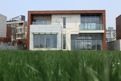 Modern house. With its lawn Royalty Free Stock Photography