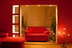 Modern house. Interior with sofa and lamp in red style Royalty Free Stock Images