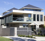 Modern house. Modern contemporary house in the suburbs royalty free stock images