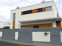 Modern house. With metal fence in residential area