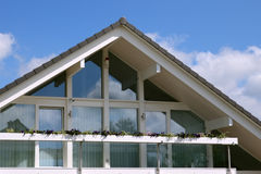 Modern house with balcony, blue sky Stock Images