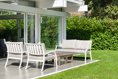 Modern house, beautiful veranda. Modern house outdoors, beautiful veranda in the garden Stock Photo