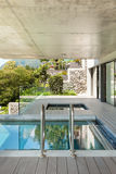 Modern house in cement, pool Stock Images