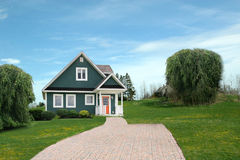 Modern house in countryside. Long paved driveway leading to modern house in countryside Royalty Free Stock Images