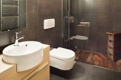 Modern house, dark bathroom Royalty Free Stock Image