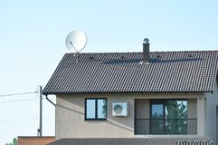 Modern house detail. House roof with blue sky on the background Stock Photography