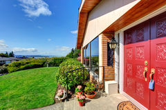 Modern house entrance porch with red door Stock Images