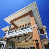 Modern house exterior. Against blue sky Royalty Free Stock Image