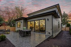 Modern house exterior with a deck at sunset. Modern house exterior with a spacious deck at sunset royalty free stock image