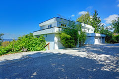 Modern house exterior with flat roof. Two story modern house exterior with flat roof, and tree car garage Royalty Free Stock Images