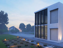 Modern house exterior with outdoor lighting at twilight Royalty Free Stock Photo