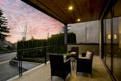 Modern house exterior with a deck at sunset. Modern house exterior with private deck overlooking downtown Kirkland at sunset stock photography