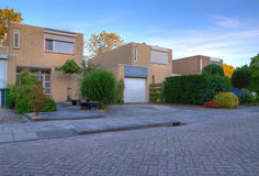 Modern house exterior. Small modern house with front yard, ramp and garage stock photo
