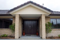 Modern House Front Entrance. A modern house entranceway and front door Royalty Free Stock Photo