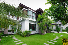 Modern house in the garden stock photography