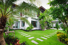 Modern house in the garden royalty free stock images
